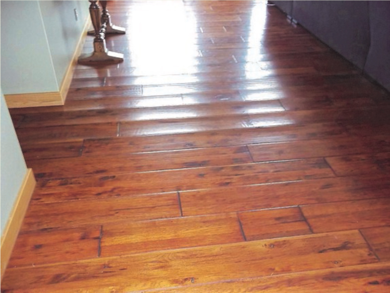 Restoration news dry tech water damage restoration services for How to fix buckling hardwood floors
